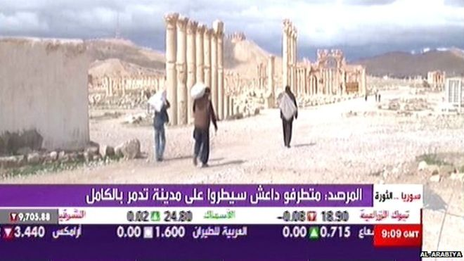 Pan-Arab TV channel Al-Arabiya showed residents leaving the city, carrying their possessions with them (via BBC)