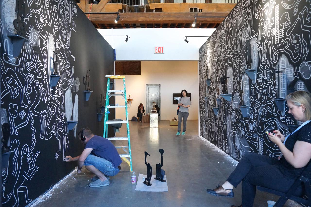 Conrad Botes drawing his installation at Bennett Contemporary