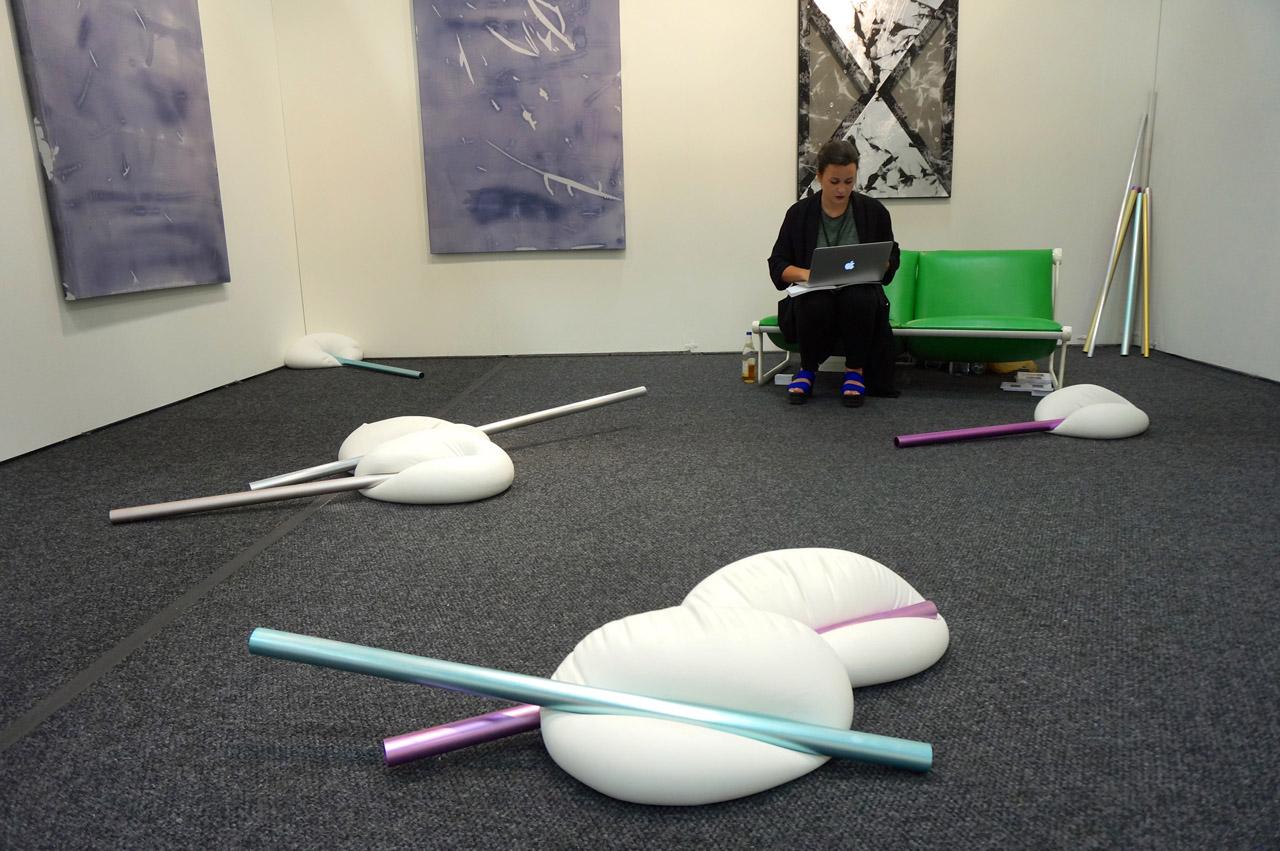 """Installation view of Vera Kox's """"*Reassuring Inertia   Ponderous Push*"""" (2014) at Duve's booth"""