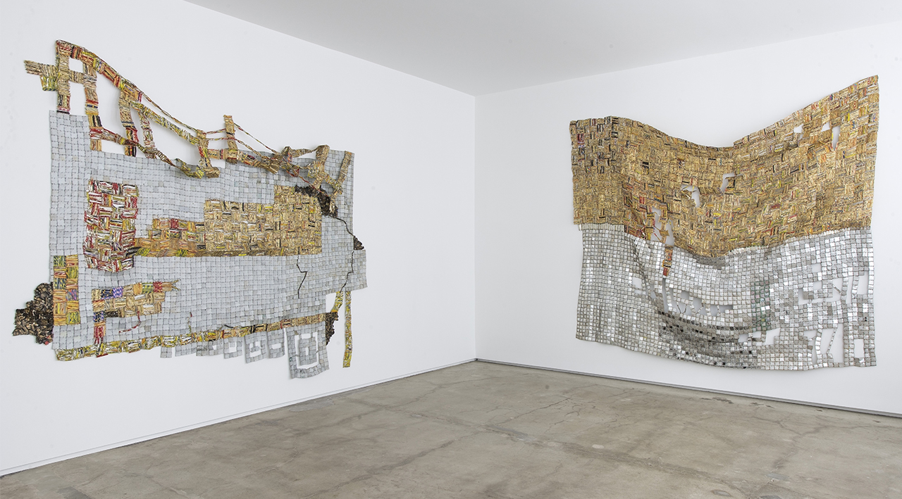 """El Anatsui's """"Ascension"""" (2014), left, and """"Dissolving Dreams"""" (2014), both found aluminum and copper wire. (photo courtesy Jack Shaiman Gallery)"""