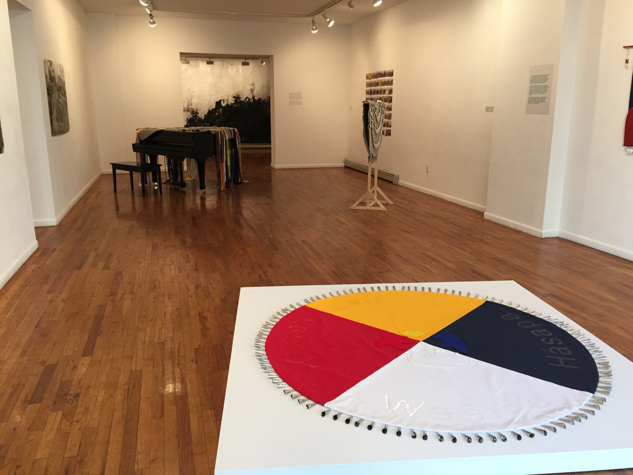 Installation view of 'How to catch eel and grow corn' at Wilmer Jennings Gallery, with a mandala by Maria Hupfield in foreground (all photos by the author for Hyperallergic)