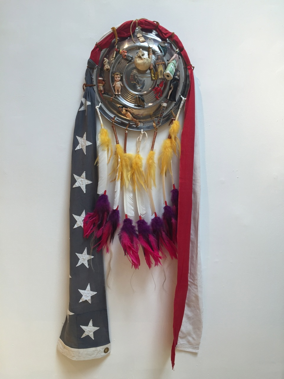 """Marcus Amerman's """"Hubcap Shield"""" in 'You Are on Indian Land' (click to enlarge)"""