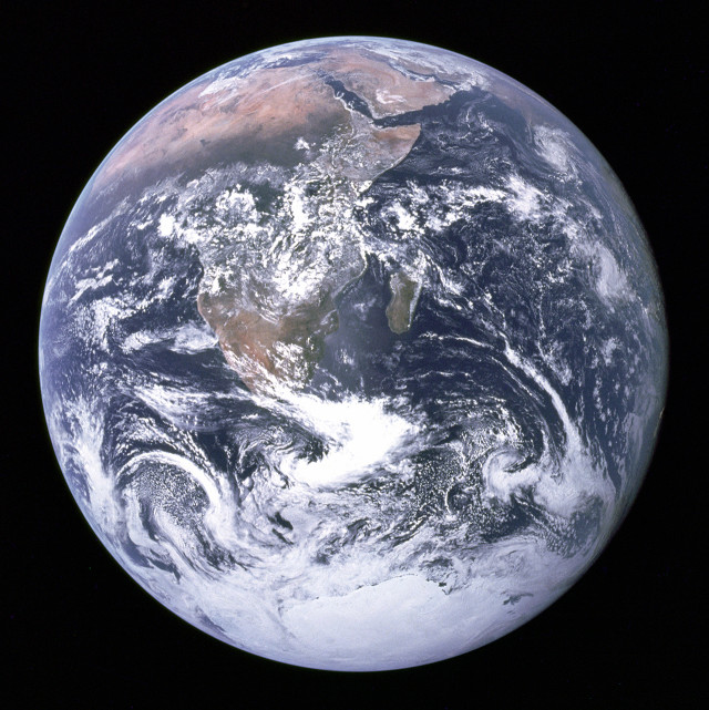 """""""The Earth seen from Apollo 17"""" by NASA/Apollo 17 crew; taken by either Harrison Schmitt or Ron Evans - http://www.nasa.gov/images/content/115334main_image_feature_329_ys_full.jpgAlt: http://grin.hq.nasa.gov/ABSTRACTS/GPN-2000-001138.html (direct link). Licensed under Public Domain via Wikimedia Commons - http://commons.wikimedia.org/wiki/File:The_Earth_seen_from_Apollo_17.jpg#/media/File:The_Earth_seen_from_Apollo_17.jpg"""