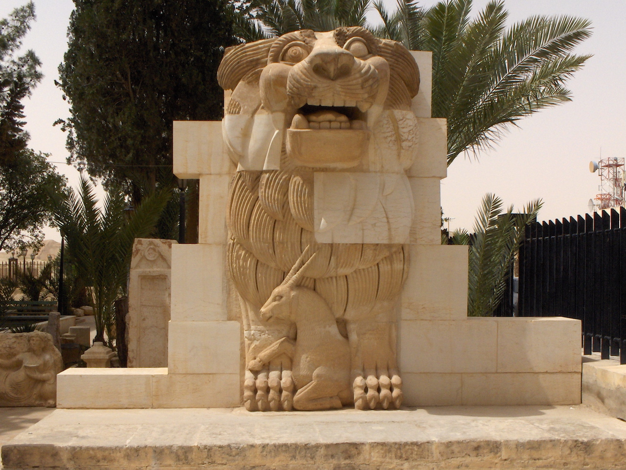 A lion sculpture dating from the first century BCE that was once part of the Temple of Allat, now on view at the Palmyra Archaeological Museum (photo by Mappo/Wikimedia Commons)
