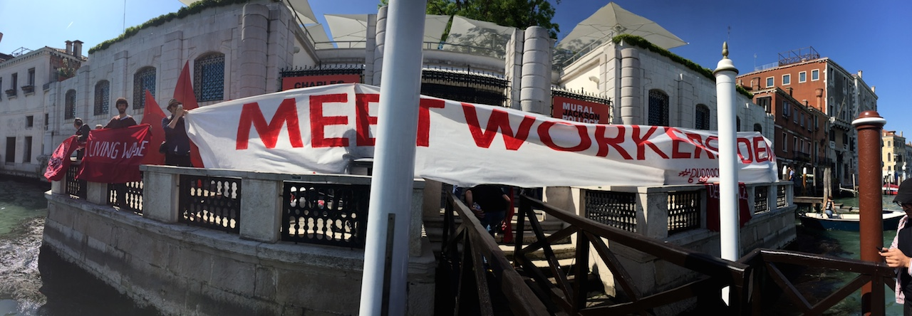 """Members of Gulf Labor occupy the Peggy Guggenheim Collection in Venice with a banner that reads """"Meet Workers' Demands"""" (all photos by the author for Hyperallergic)"""