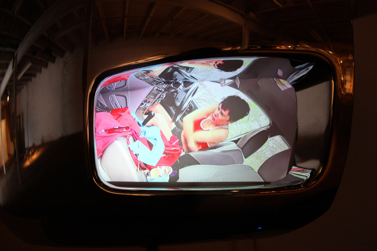 Still from one of Melanie Mano's headlight feeds in 'Detroit Boom City' (all photos by the author for Hyperallergic)