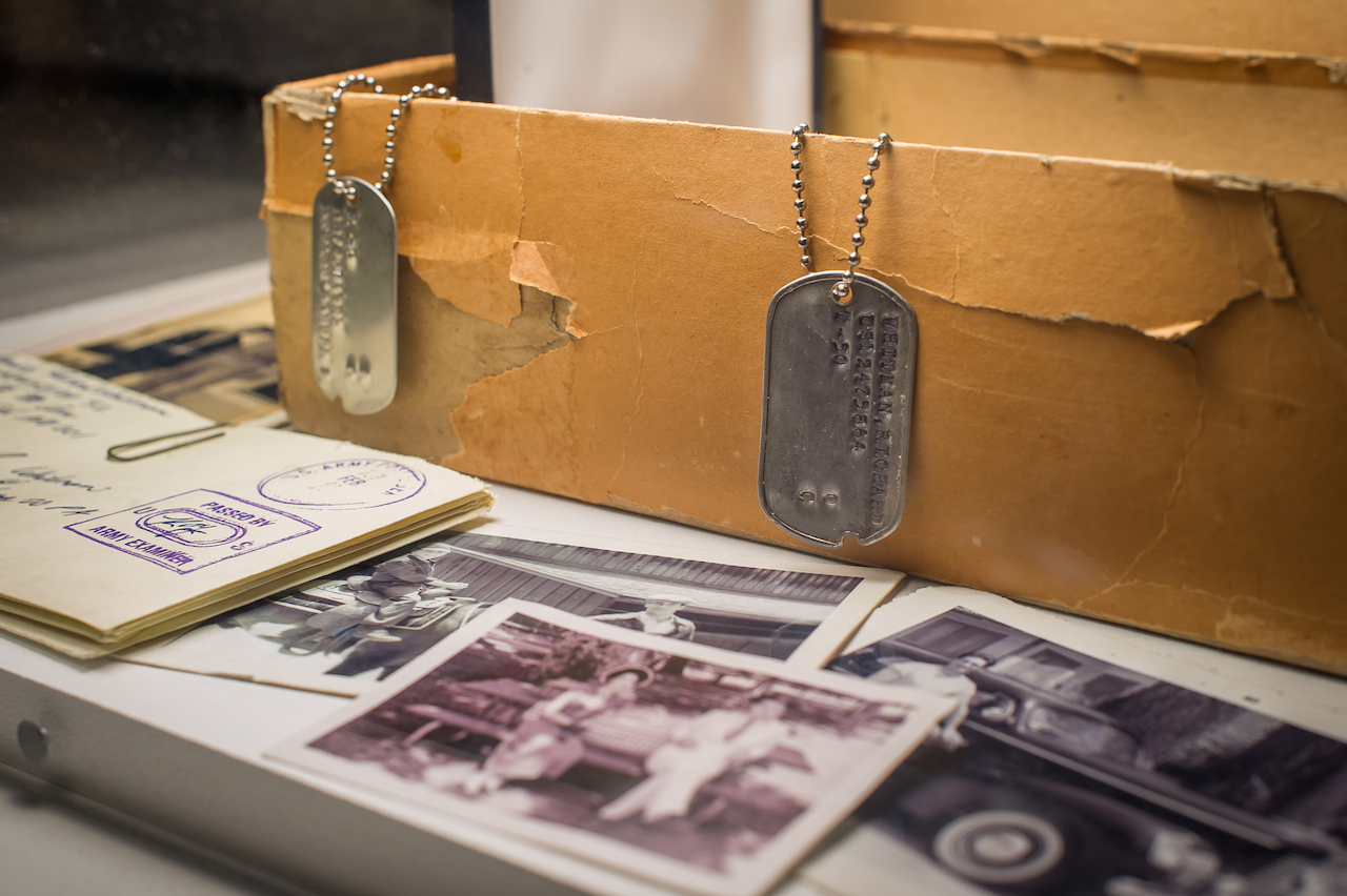 """New York - March 10, 2015. At the Museum of the Moving Image press preview for the exhibition """"Matthew Weiner's Mad Men."""" Detail: Don Draper's box of secrets revealed. Shown: Dick Whitman's dogtag, letters, and family photos. Photo: Thanassi Karageorgiou / Museum of the Moving Image."""