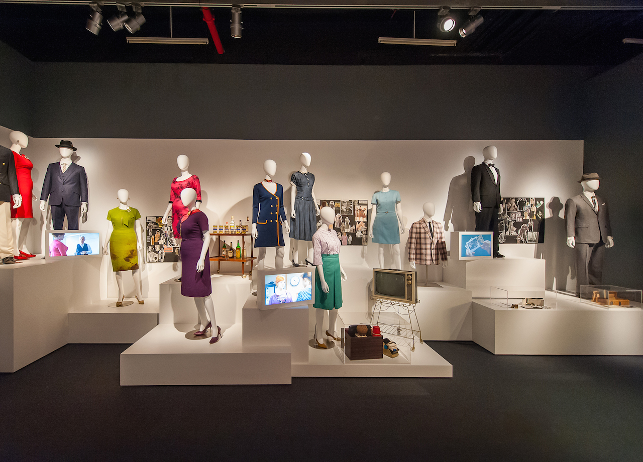 """New York - March 10, 2015. At the Museum of the Moving Image press preview for the exhibition """"Matthew Weiner's Mad Men."""" Installation view of """"Creating Character"""" section, which features costumes and props for characters including Don Draper, Peggy Olson, Joan Holloway/Harris, Roger Sterling. (Not shown in this photo, but also included in the exhibition are costumes and props for Megan Draper, Betty Draper/Francis, Sally Draper, Pete Campbell, Henry Francis, two secretaries, and two of Megan's friends.) Photo: Thanassi Karageorgiou / Museum of the Moving Image."""