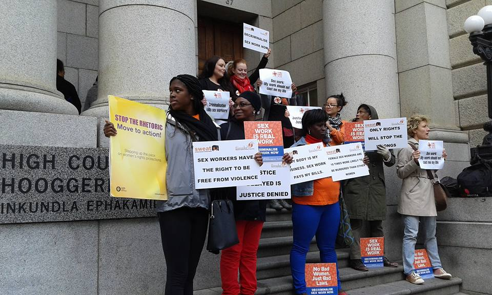 Protesters from SWEAT, as well as Sisonke, Sonke Gender Justice, and other organizations, outside Zwelethu Mthethwa's trial in Cape Town (all photos via SWEAT/Facebook)