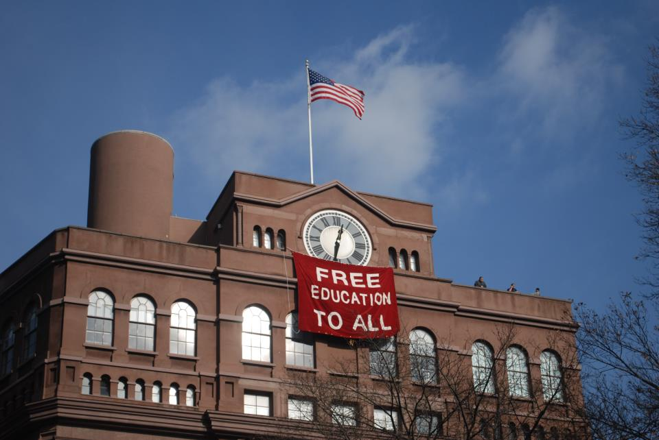 A banner hung by students from the Cooper Union Foundation Building during a student occupation of the building's historic clocktower in December 2012. (photo by Free Cooper Union)