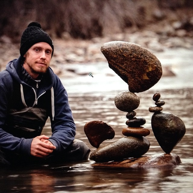 Michael Grab with some of his stone stacks (photo by GravityGlue/Instagram)