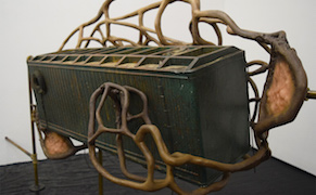 """Detail of Dora Budor, """"Our Children Will Have Yellow Eyes"""" (2015), screen-used miniature rooftop from 'Johnny Mnemonic' (1995), steel armature, epoxy clay, infected silicone prosthetics, acrylic polymer with pigment suspension, sfx and weathering paint, and assorted metal hardware"""