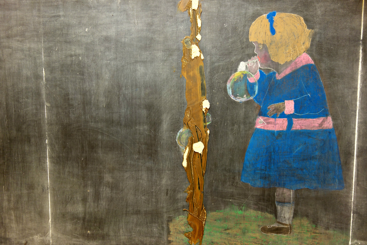 A 1917 chalkboard drawing of a girl blowing bubbles discovered last June (photo by the author for Hyperallergic)