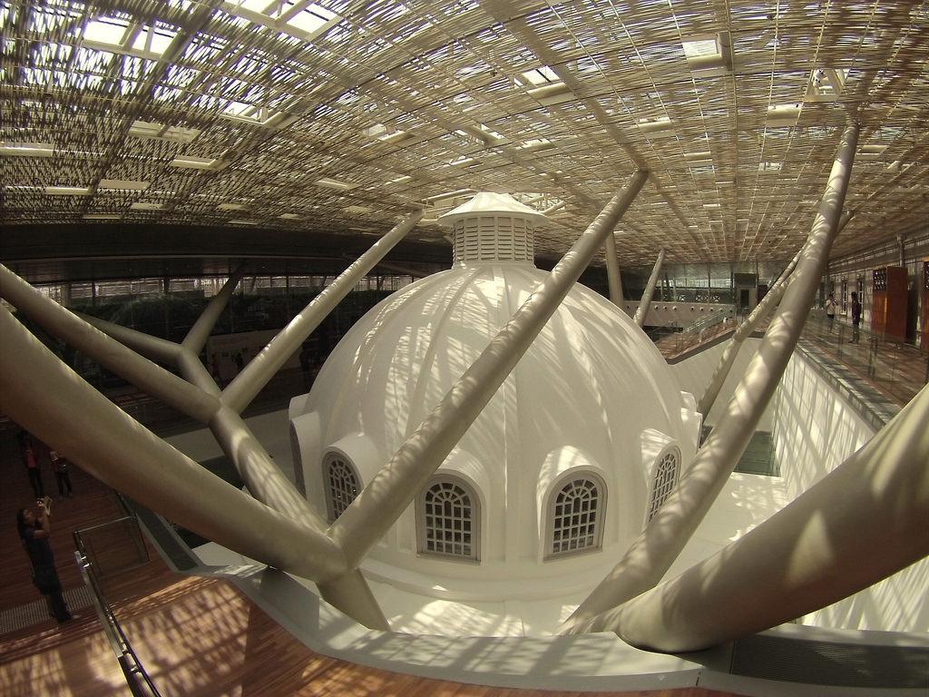 Rotunda dome of National Gallery Singapore beneath the paneled roof