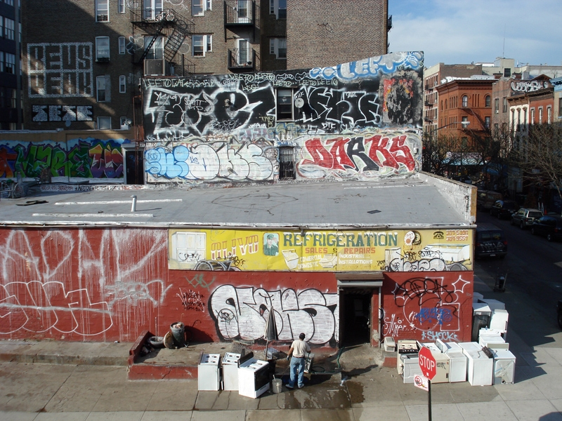 Graffiti tags and a handpainted sign in New York City