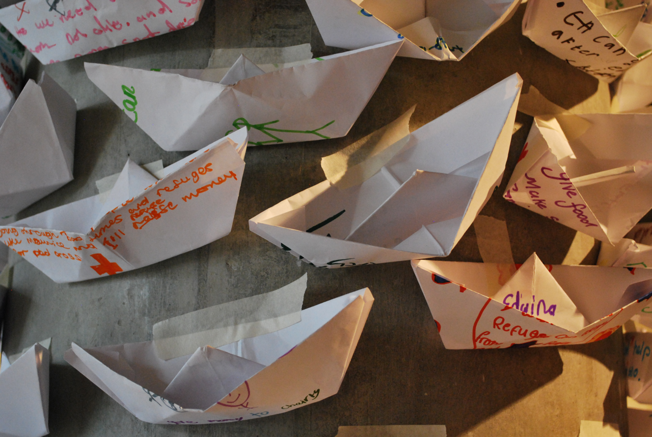 Installation shot of paper boats made by children at Hackney Museum.