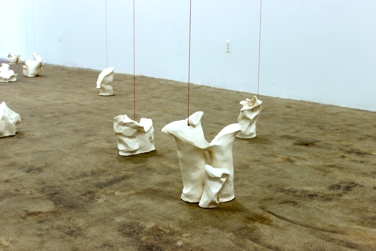 """The porcelain bases of """"Tensions (red)"""" emulate tree stumps."""