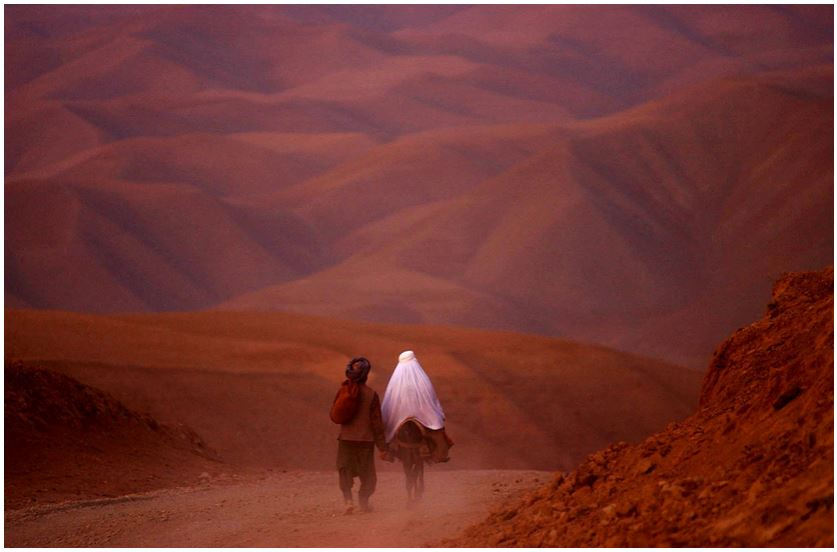 James Hill. A couple went down the barren roads of Badakhshan province, North Afghanistan, 2001