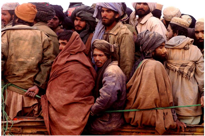 James Hill. Taliban prisoners squeezed onto a truck in the desert, North Afghanistan, November 2001