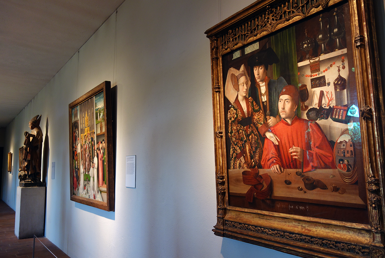 "Installation view of 'Treasures and Talismans: Rings from the Griffin Collection,' with at right: Petrus Christus, ""A Goldsmith in his Shop"" (Netherlandish, 1449), oil on oak panel"