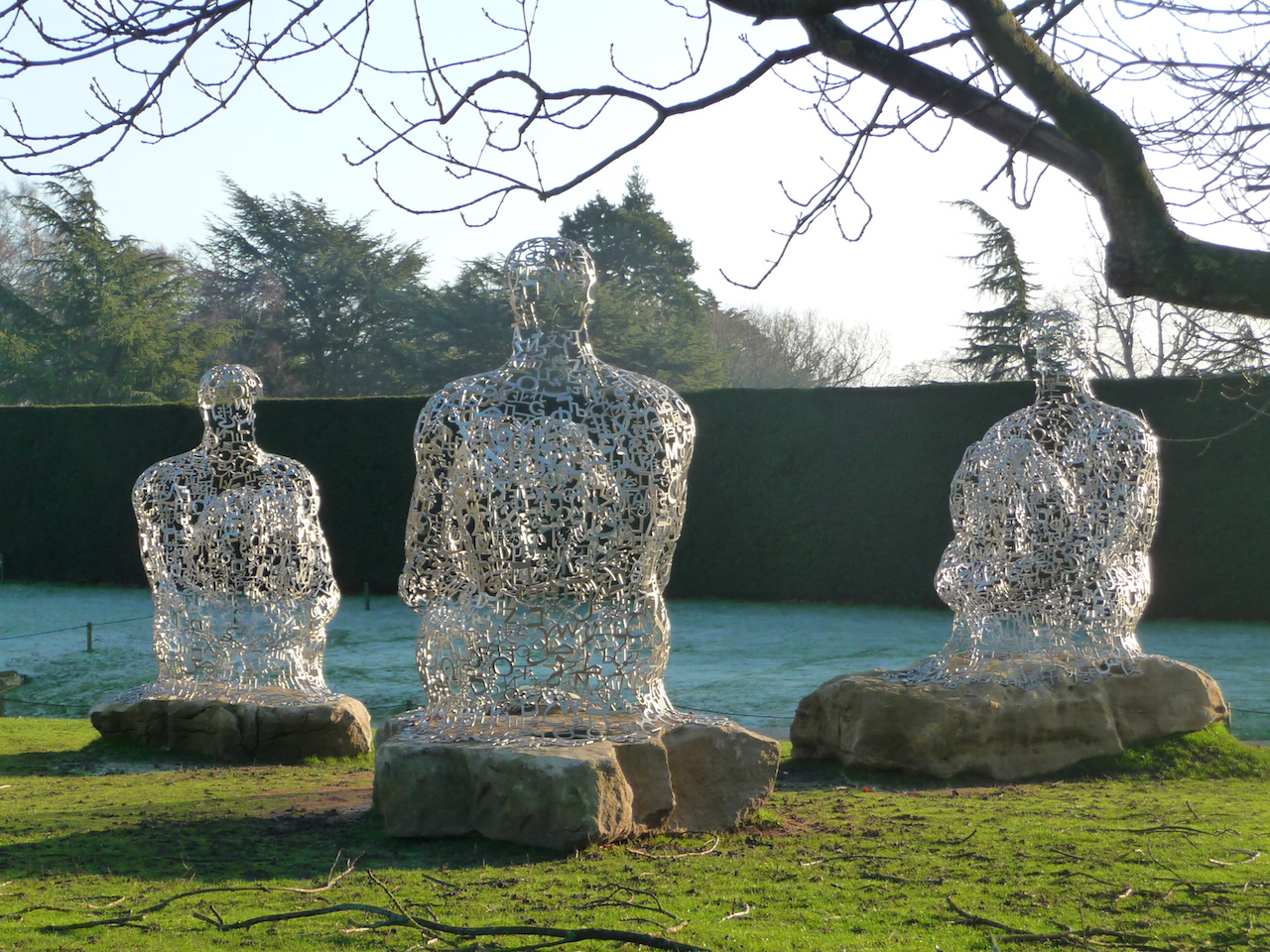 """Jaume Plensa sculptures (""""Yorkshire Souls I, II, and III"""") similar to the one recently stolen from a gallery in Montreal. (photo by Lorraine#/Flickr)"""