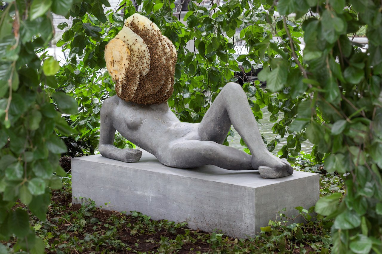 """Pierre Huyghe, """"Untilled (Liegender Frauenakt) [Reclining female nude]"""" (2012), concrete with beehive structure, wax, and live bee colony (courtesy the Museum of Modern Art, © 2015 Pierre Huyghe, photo by Jonathan Muzikar)"""