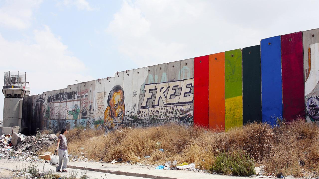 Khaled Jarraru0027s Rainbow Mural U201cThrough The Spectrumu201d Painted On The Israeli  Separation Wall Near