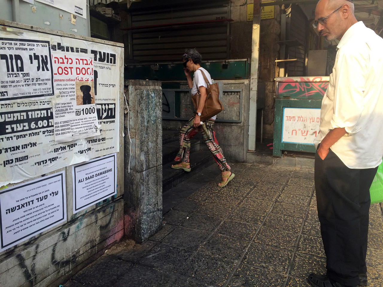A man in Jerusalem reading one of the posters.