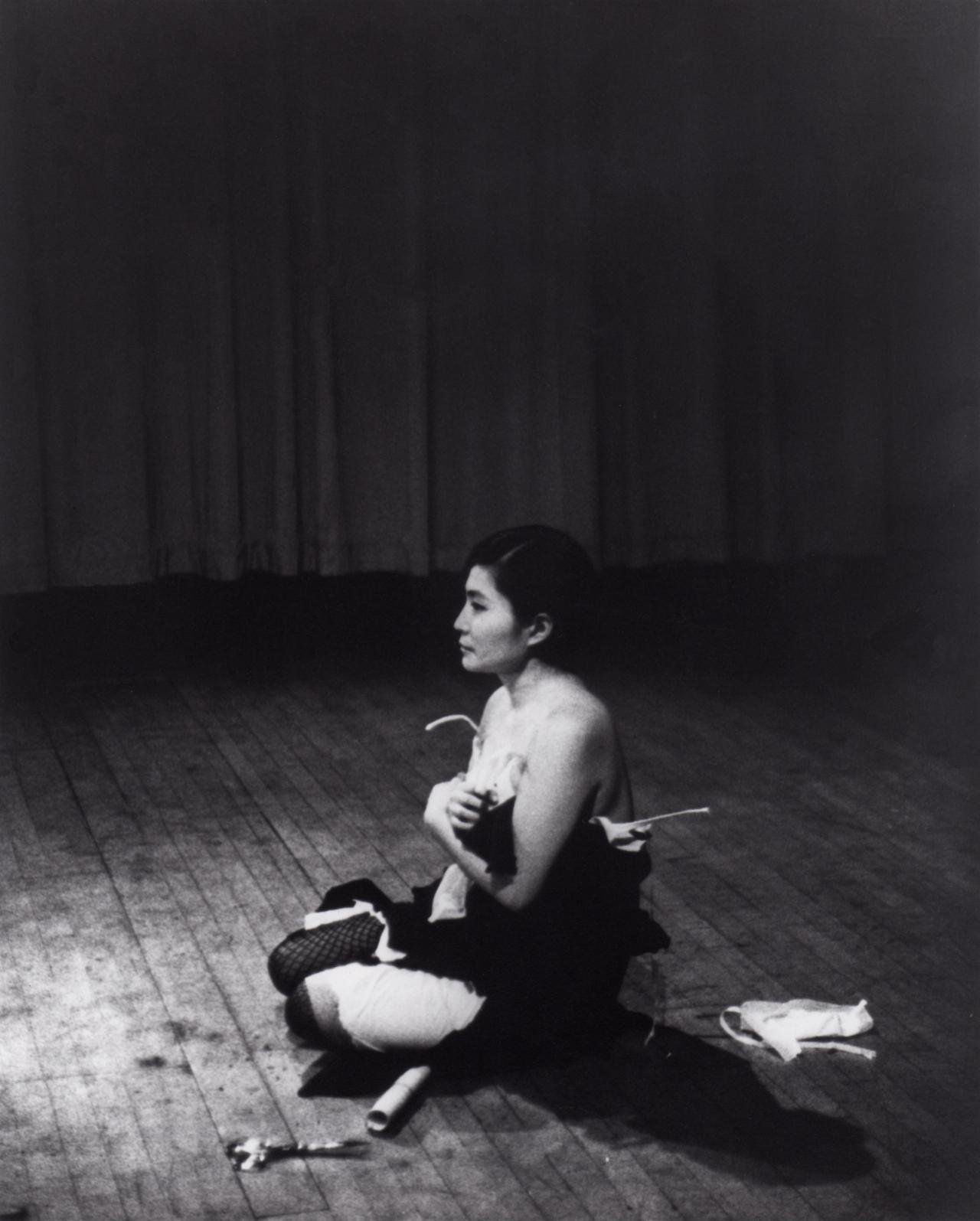 Cut Piece (1964) performed by Yoko Ono in New Works of Yoko Ono, Carnegie Recital Hall, New York, March 21, 1965. Photograph by Minoru Niizuma. © Minoru Niizuma. Courtesy Lenono Photo Archive, New York
