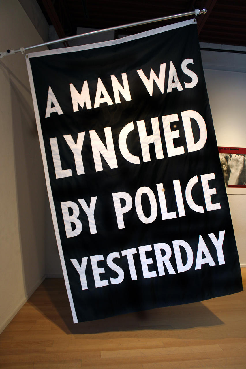 fig 1 Dread Scott, A Man Was Lynched By Police Yesterday, installation photograph, courtesy of Moberg Gallery, Des Moines Iowa, July 2015