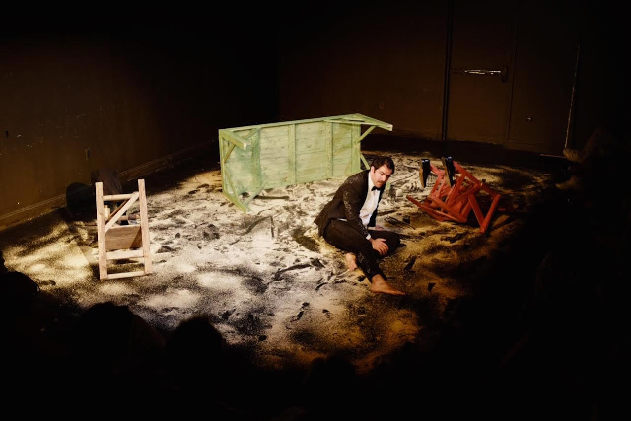 Christopher Domig recites T.S Eliot's Wasteland amidst sawdust in 'The Wasteland' (2015) (photo by Thomas Weitzman, courtesy of the Wasteland Project)