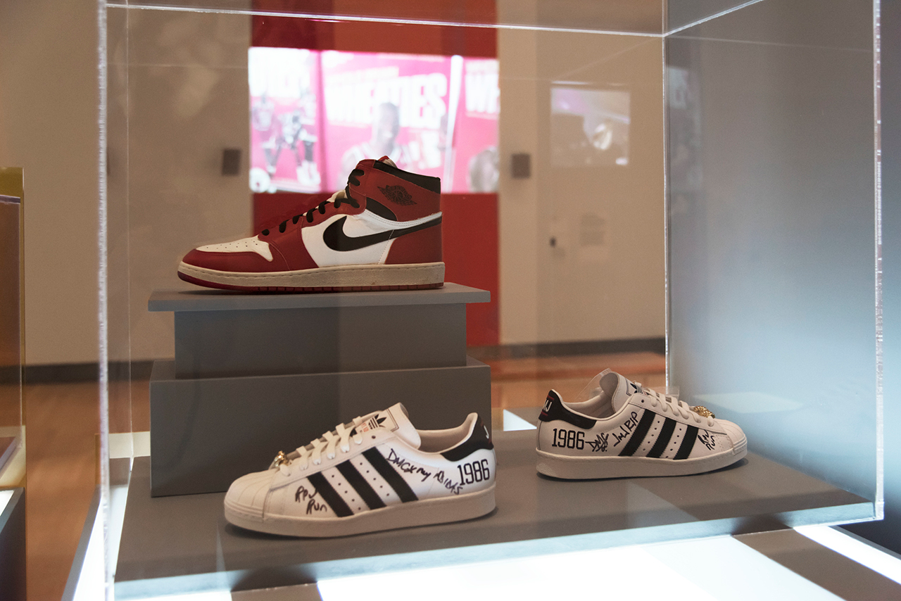 Installation view, 'The Rise of Sneaker Culture' at the Brooklyn Museum, showing Nike's Air Jordan I (1985) on top and the adidas x Run–DMC 25th Anniversary Superstar (2011) below (© Jonathan Dorado)
