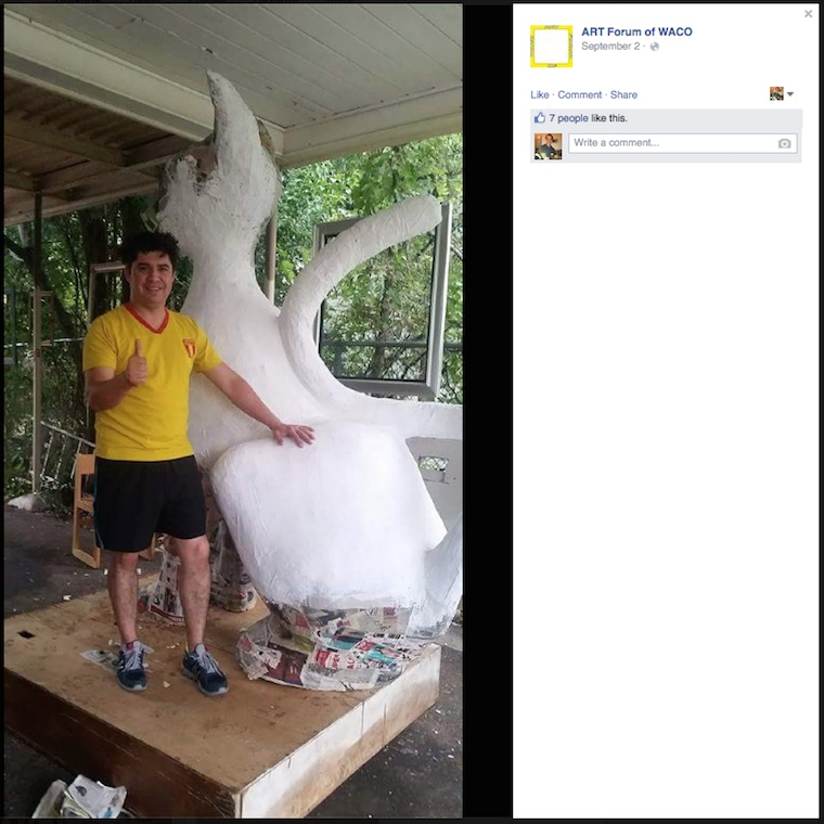 Artist Jesus Rivera with his cat sculpture before it was destroyed. (screenshot by the author, via Facebook)