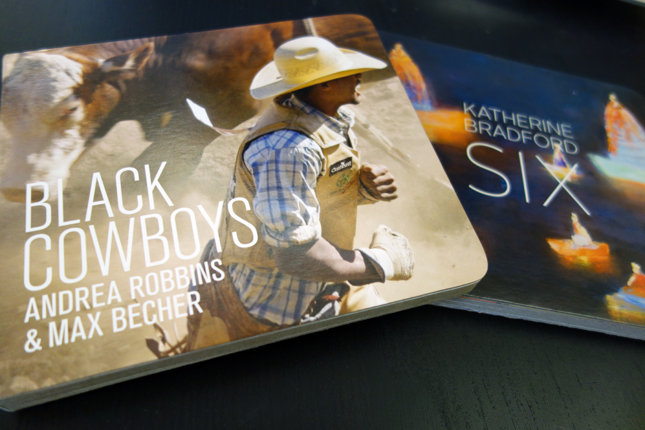 'Black Cowboys' by Andrea Robbins & Max Becher and 'Six' by Katherine Bradford (photo of the books for Hyperallergic)