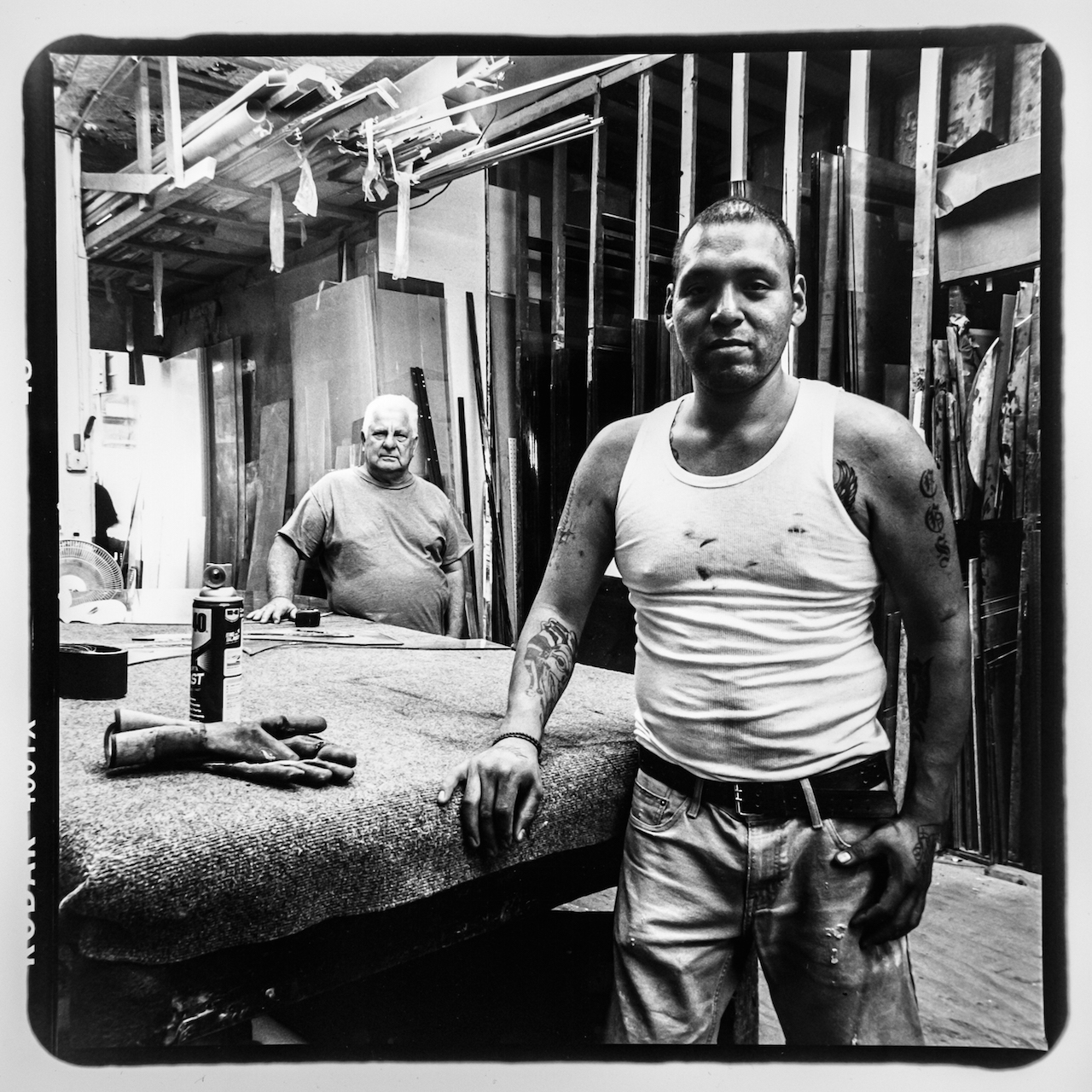 Kevin Mendoza (front) and Pepe (no last name) from Fordham Glass & Windows located on Jerome Avenue and 183rd. Kevin is retiring soon and Pepe will take over the business. Photo taken August 2015 by Jonathan Santiago/Bronx Photo League.