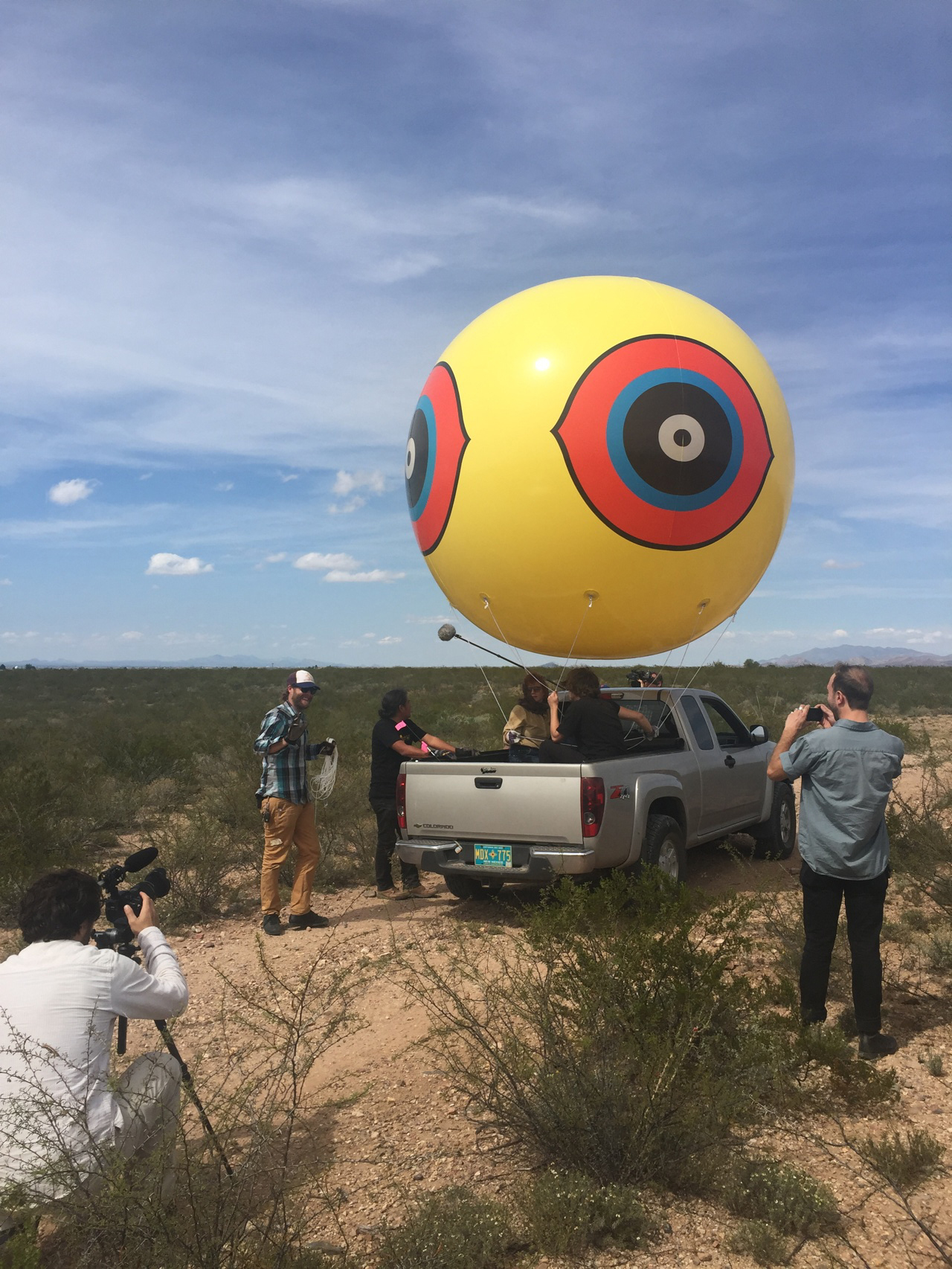 """Unloading one of the balloons for Postcommodity's """"Repellent Fence"""" on the Arizona side of the border (all photos by the author for Hyperallergic unless otherwise noted)"""
