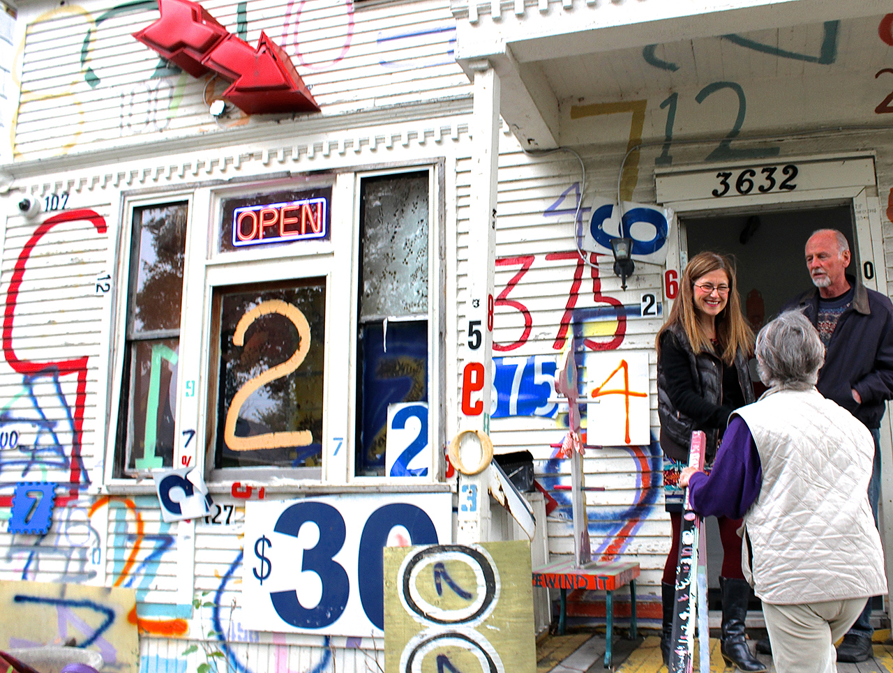 """Dickason greets visitors on the """"Number House"""" porch"""