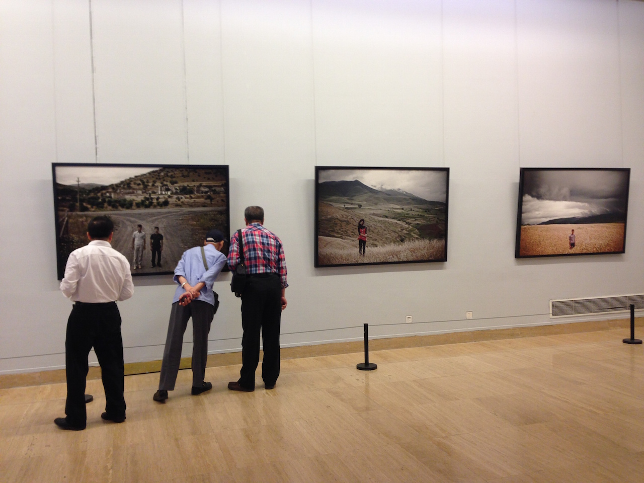 Visitors to the Armenian special exhibition examine photographs by Karen mirzoyan (photo by Anna Gargarian)