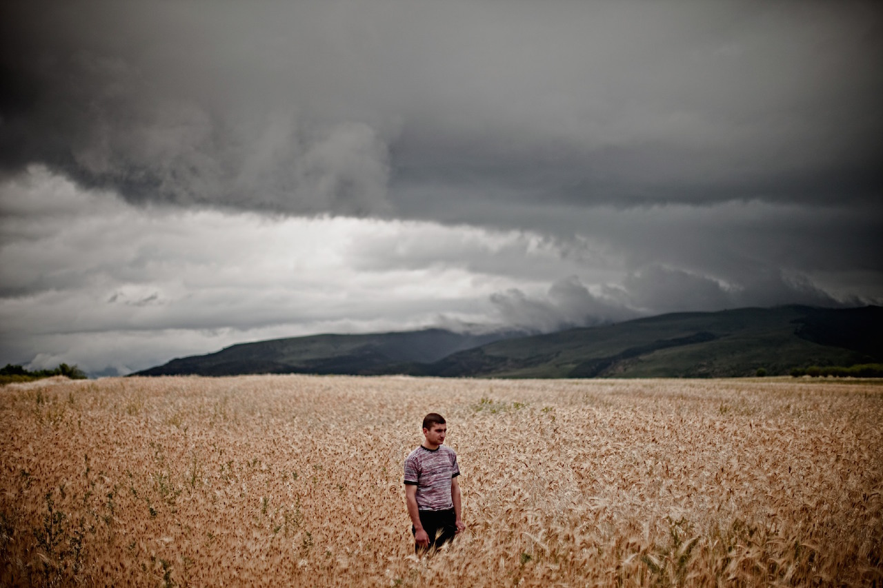 """Karen Mirzoyan, """"Artur Hagopyan, age 21, car mechanic. His father Artavazd died on this field on the road to Aghdam on June 12, 1993"""" from Karabagh War Series, Chapter 3: The Future (2010)"""
