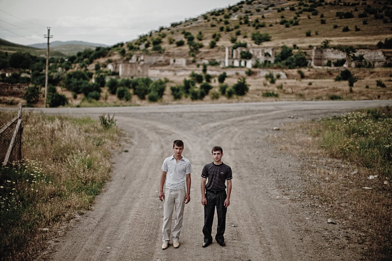 """Karen Mirzoyan, """"Nikolai and Vahag Hayrapetyan, ages 18 and 17. Their father Garegin died at the age of 31 on this crossroad in Nor Karmiravan, Mardakert"""" from Karabagh War Series, Chapter 3: The Future (2010)"""