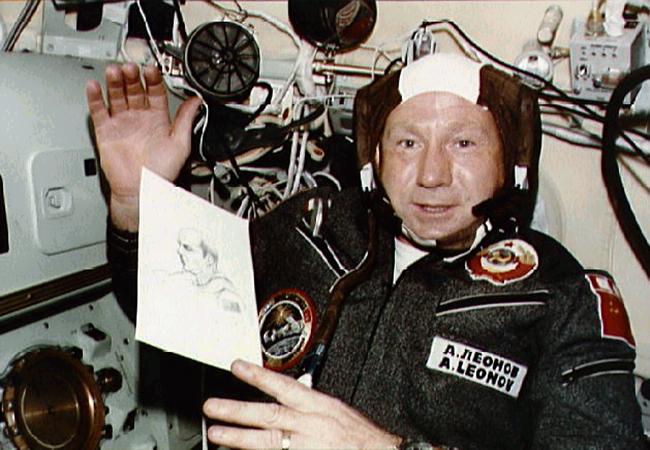 Alexei Leonov with a sketch of American astronaut Thomas Stafford during the Apollo-Soyuz mission (via NASA)