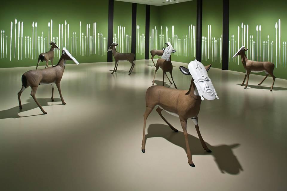 "Brendan Fernandes, ""Neo Primitivism 2"" (2007-14), installation with plastic masks, deer decoys, and vinyl spears (via facebook)"