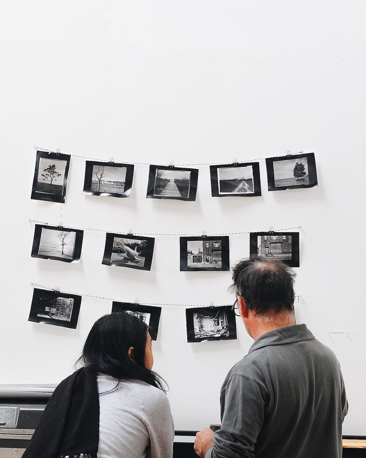 Visitors looking at work in the Gowanus Print Lab during Gowanus Open Studios