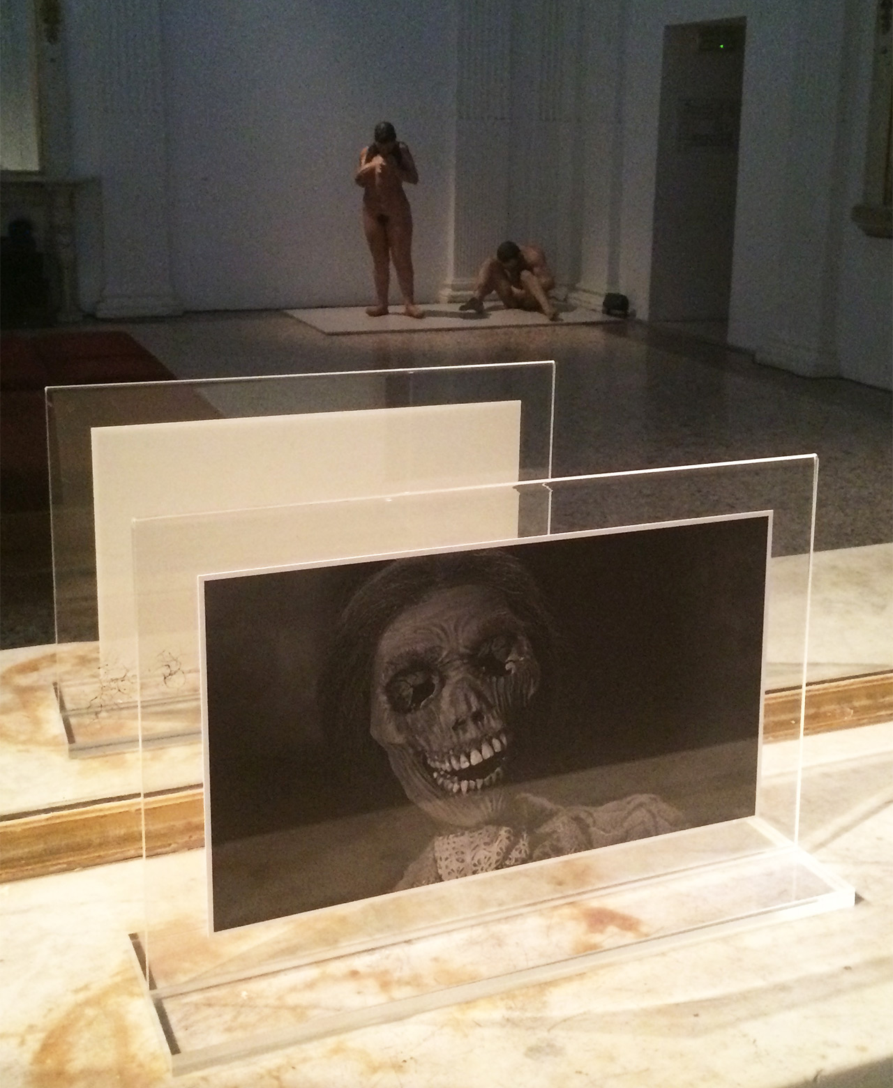 "Installation view with a still from Alfred Hitchcock's 'Psycho' (1960) in the foreground and Kiki Smith's ""Mother/Child"" (1993) reflected in the mirror"