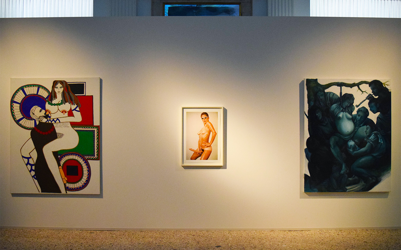 "Installation view with, from left to right, Dorothy Iannone's ""Suck my breasts I am your most beautiful mother"" (1970–71), Lynda Benglis's ""Lynda Benglis Advertisement in Artforum, November 1974"" (1974), and Nicole Eisenman's ""Hanging Birth"" (1993)"