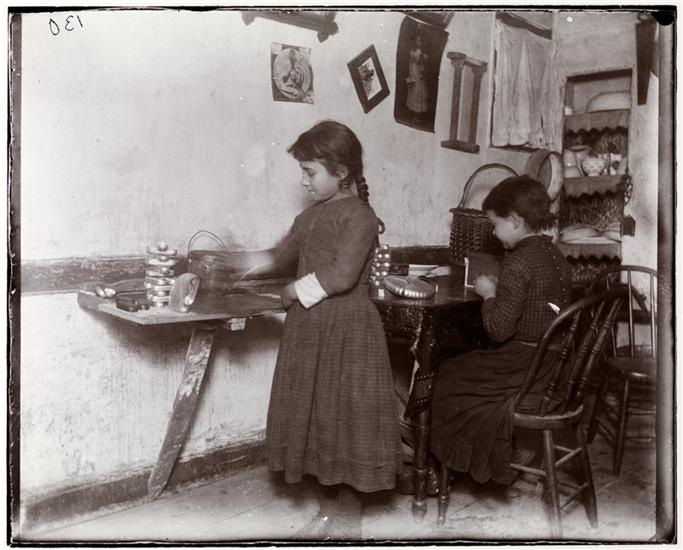 """""""Little Susie in Gotham Court,"""" photo by Jacob A. Riis (1892) (courtesy Museum of the City of New York, Gift of Roger William Riis)"""