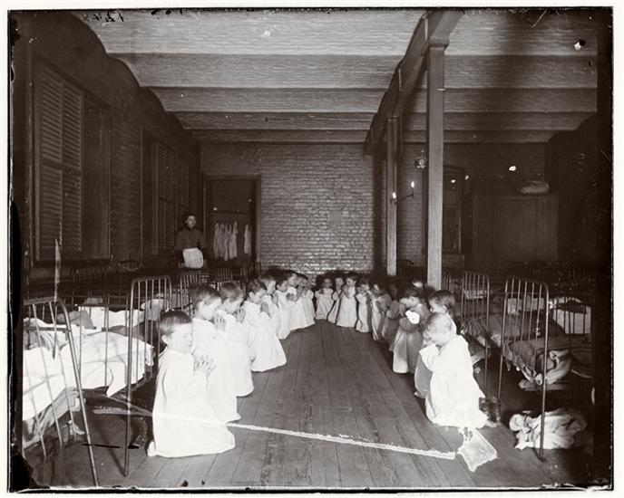 """""""Prayer-Time in the Nursery, Five Points House of Industry,"""" photo by Jacob A. Riis and unknown (1887-1888) (courtesy Museum of the City of New York, Gift of Roger William Riis)"""
