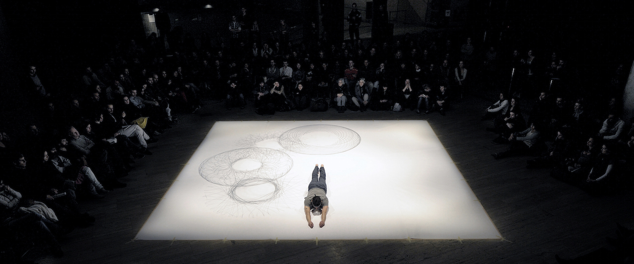 "Tony Orrico performing ""Penwald: 2: 8 circles: 8 gestures"" at CCCB, Barcelona in 2011 (photo by David Ruano, courtesy the artist)"