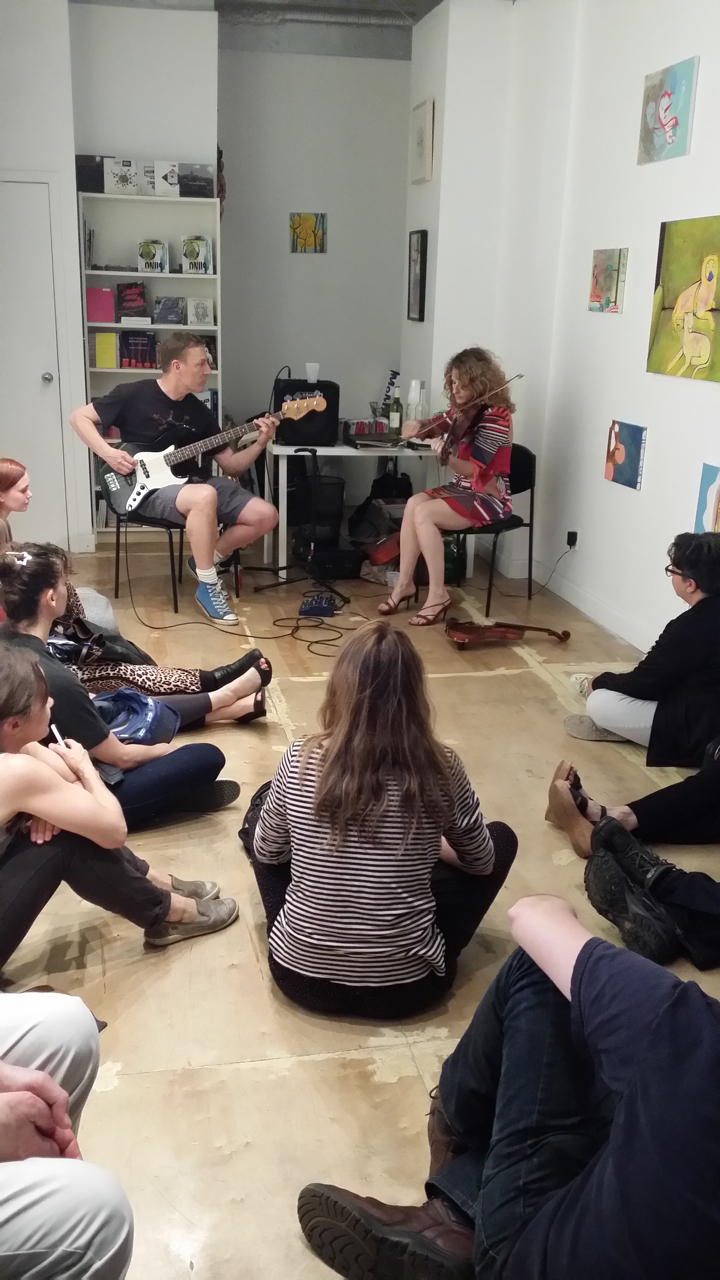 "Performance during David Humphrey and Jennifer Coates' ""Plush Onus"" exhibition at Arts & Leisure, April 2015 (photo courtesy of Nick Lawrence)"