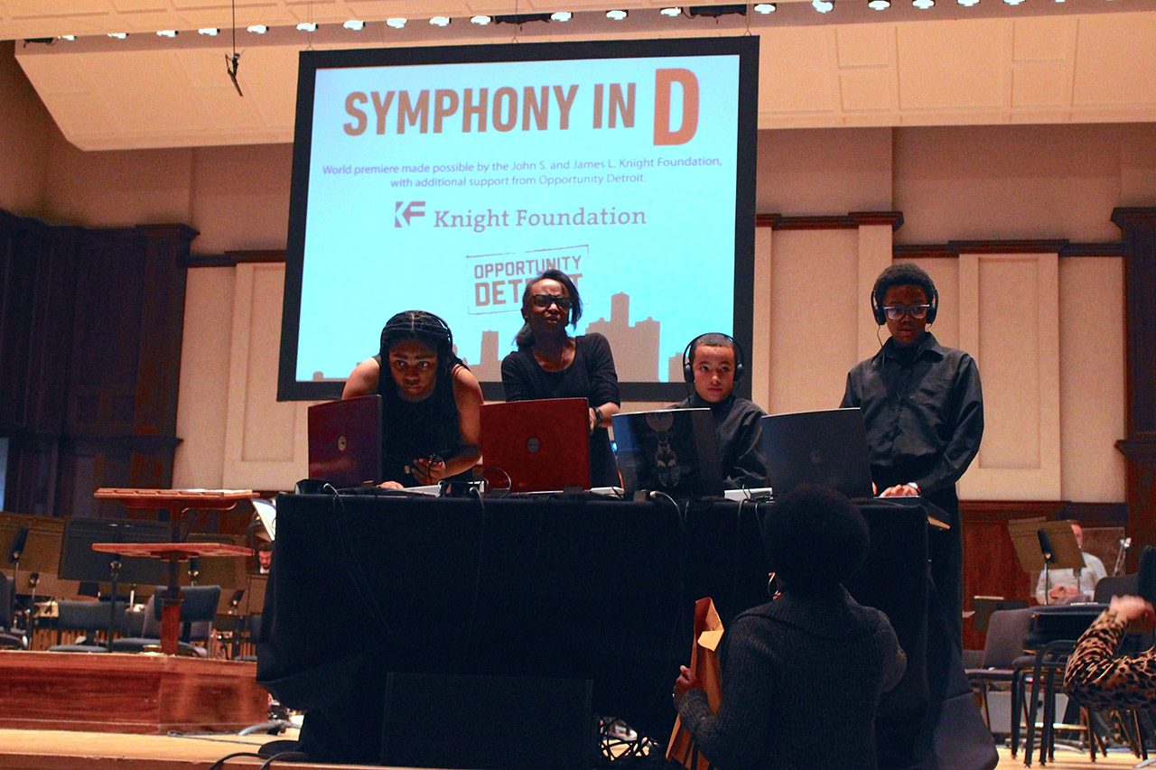 Students from YouthVille Detroit prepare to perform in 'Symphony in D' (all photos by the author for Hyperallergic)